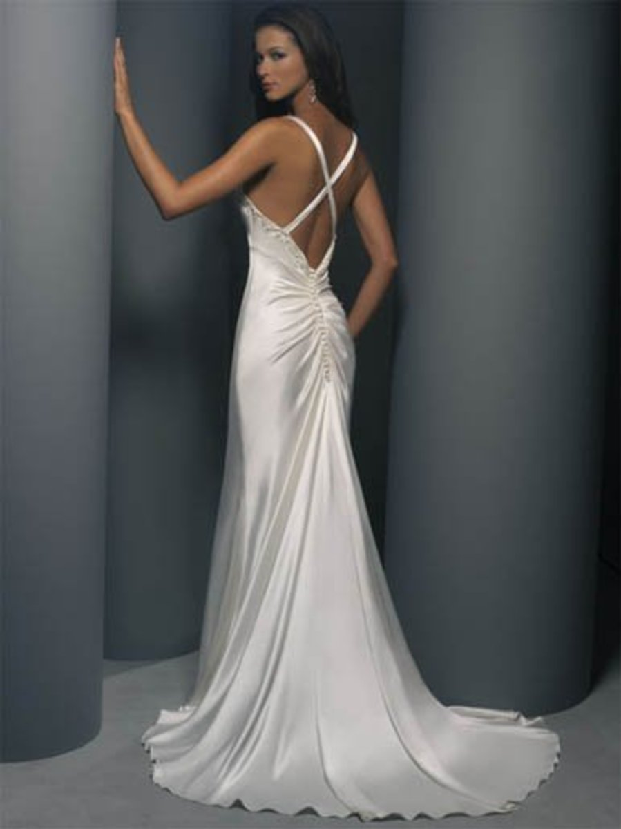Destination Wedding Dress: Demetrios Destination Romance Wedding Dress Style DR126 Satin charmeuse V-neck sleevless sheath, criss-cross back with buttons down zipper.