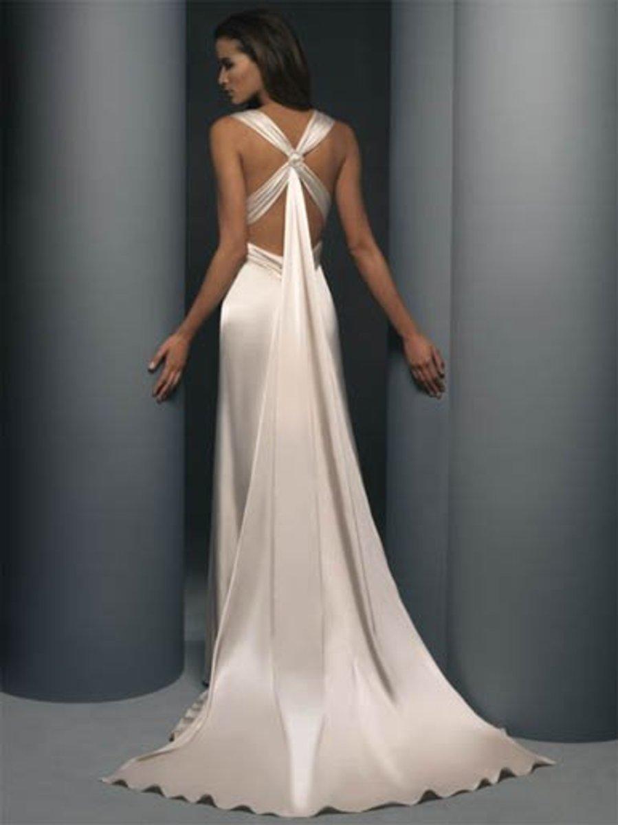 Destination Wedding Dress: Demetrios Destination Romance Wedding Dress Style DR134 Satin charmeuse halter, empire boice, criss-cross open back.