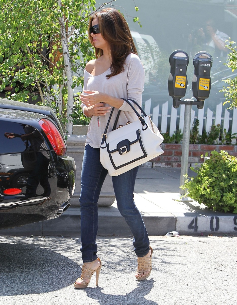 Eva Longoria in skin tight jeans and sexy stilettos