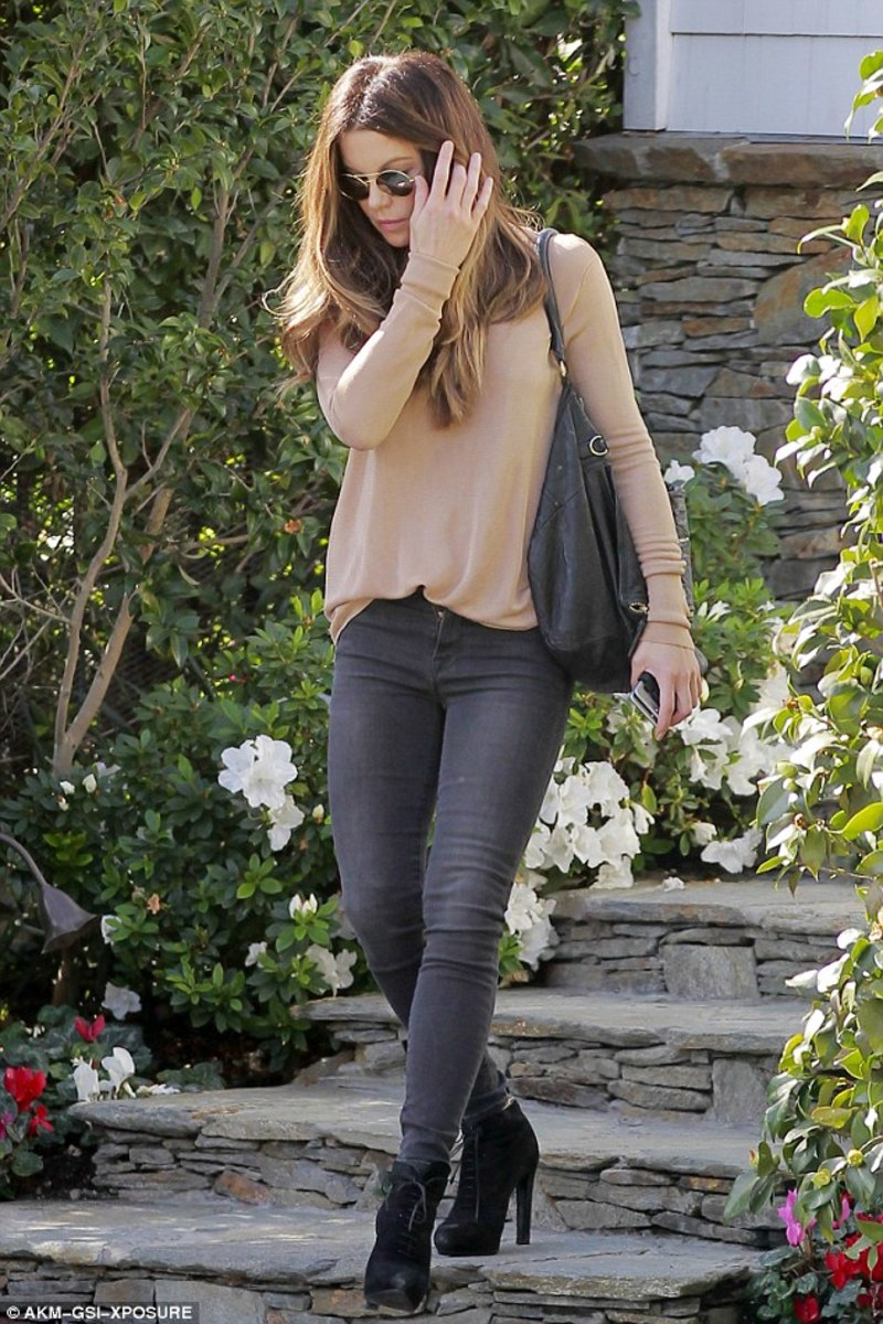 Kate Beckinsale street style in dark denim and high heel boots