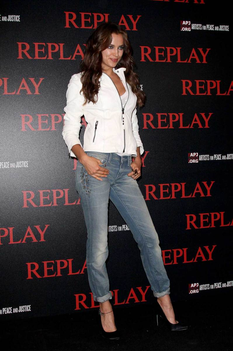 Irina Shayk posing on the event carpet in faded skinnies and towering heels