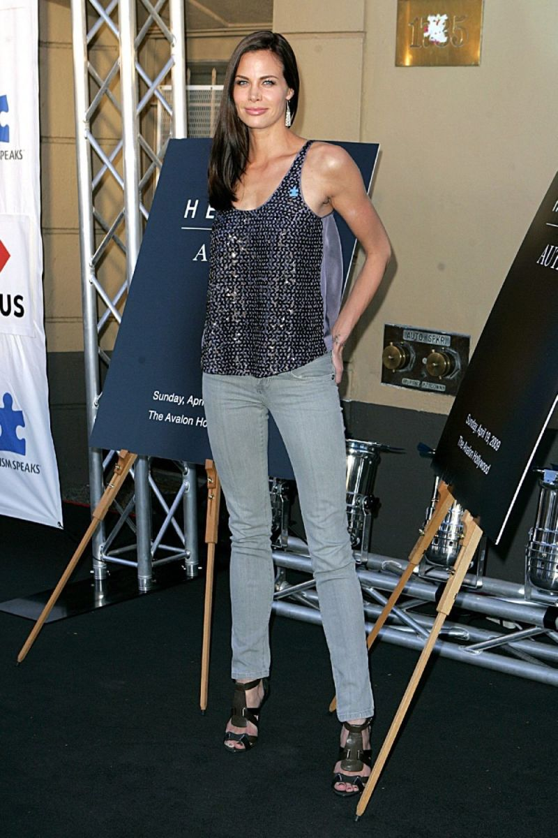 Brooke Burns long legs in her gray slim pants