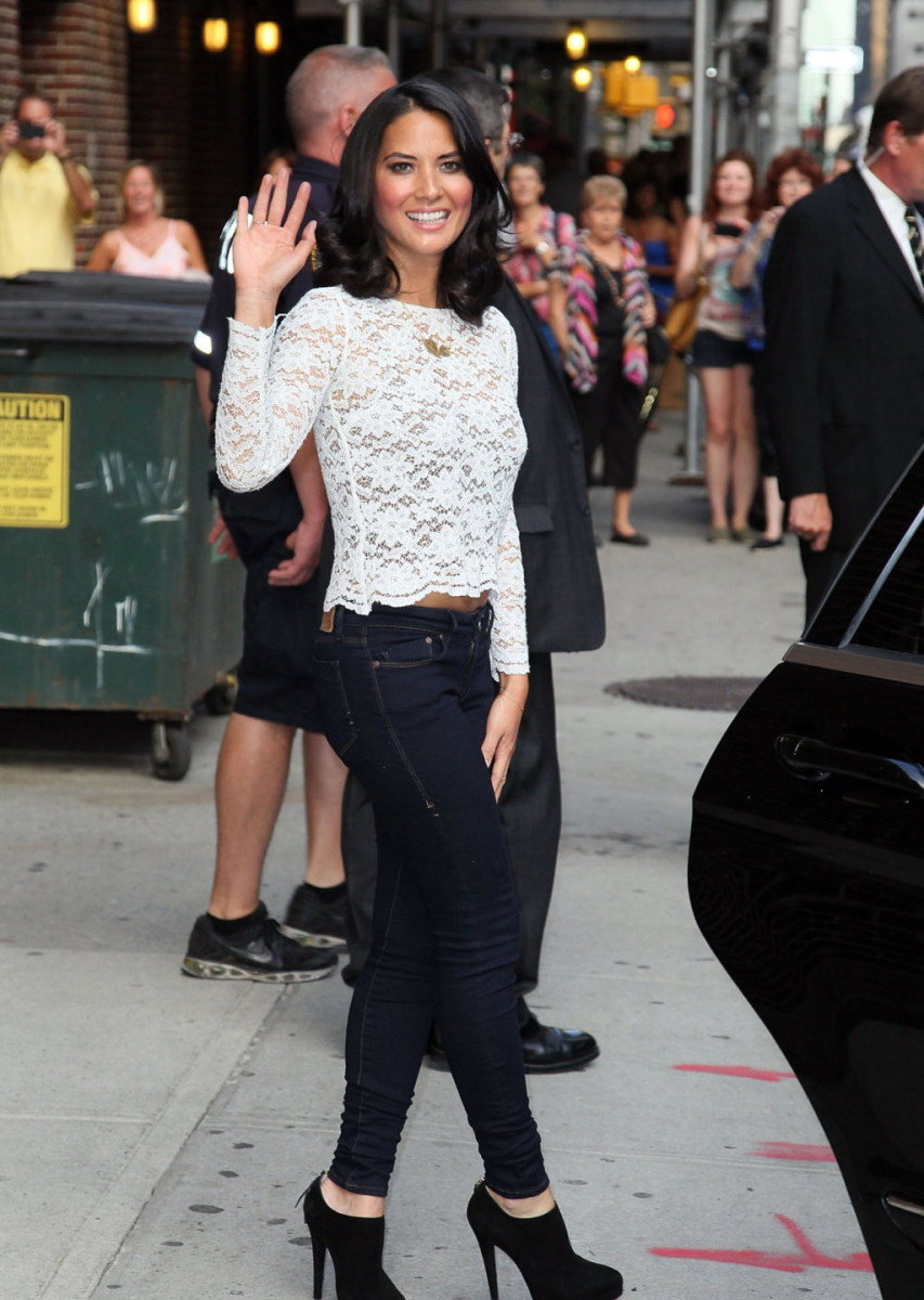 Olivia Munn outside the Late Show in dark denim and high heel booties