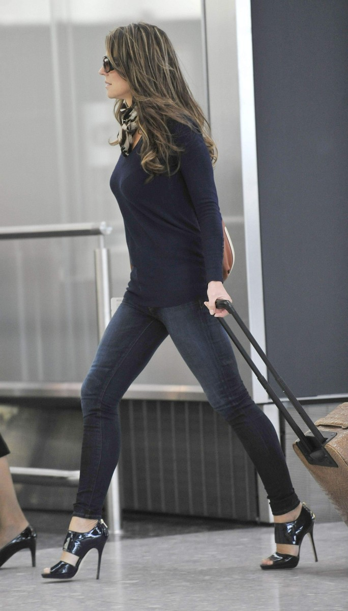 Elizabeth Hurley leaving the airport wearing dark denim and sky high heels