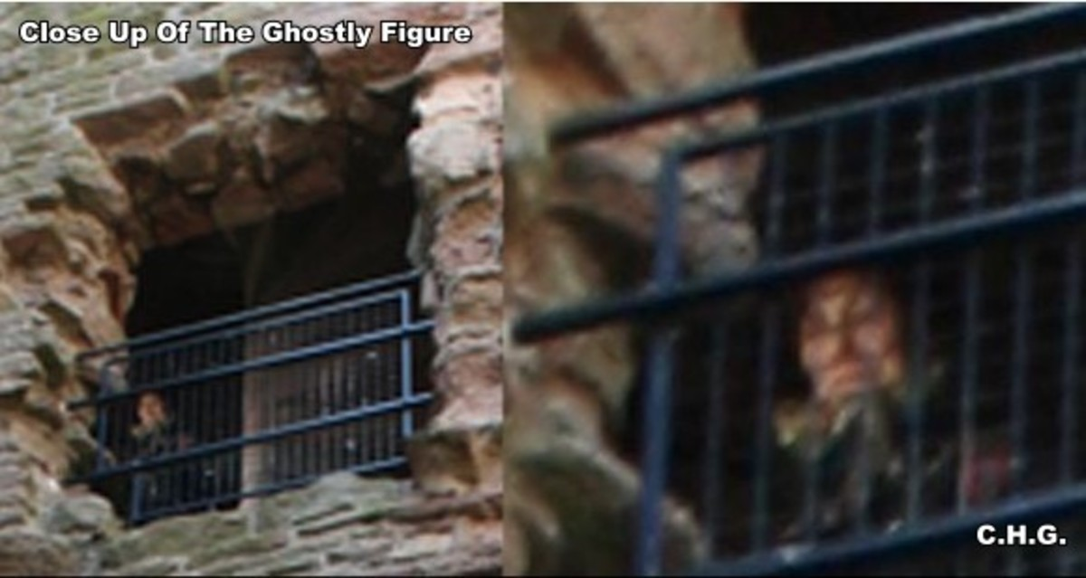 Close up of the ghostly figure looking out the gate. Notice his middle ages collar.And his face is very clear.