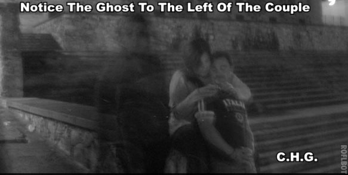 Notice the ghostly figure to the left of the couple having their photo taken.