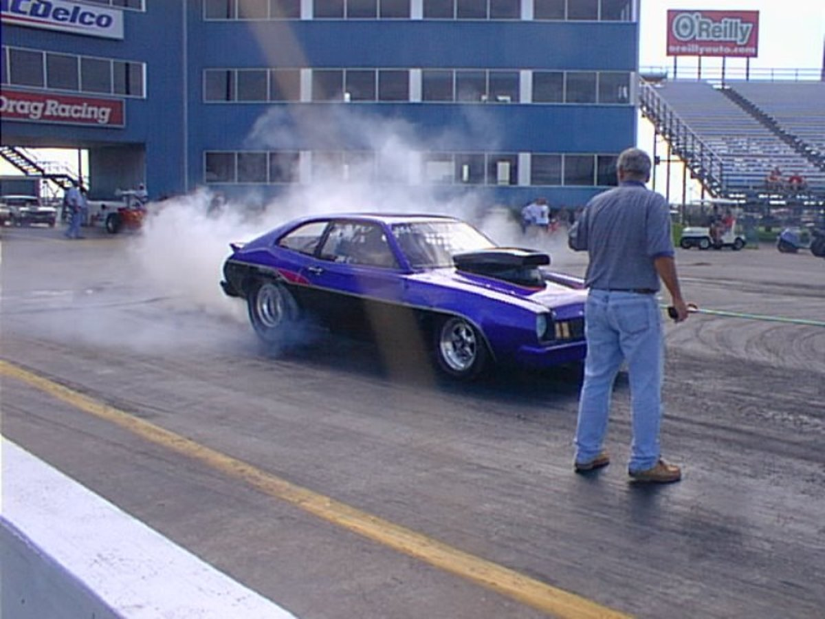 Doing a burnout heats up the slicks (racing tires) for better traction.