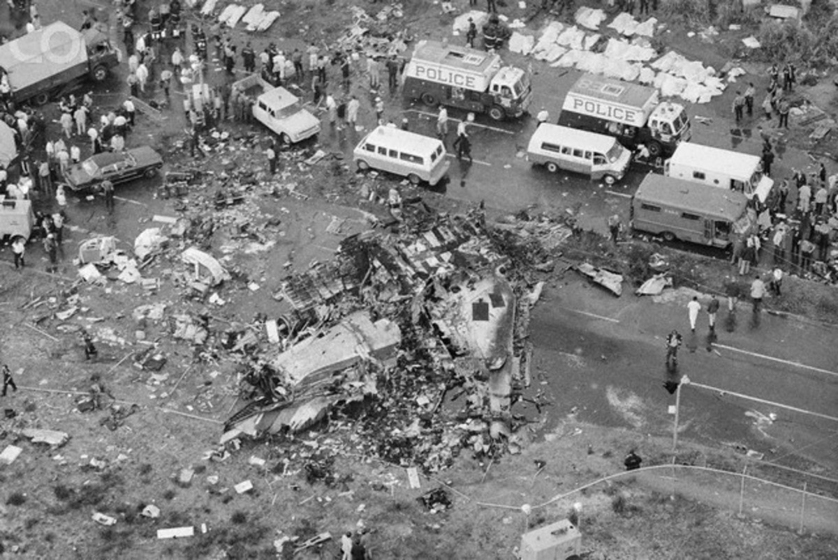 Aerial view shows wreckage, rescue vehicles and shroud-covered bodies of victims of ill-fated Eastern Airlines' Boeing 727 which crashed during an apparently normal landing approach to the airport