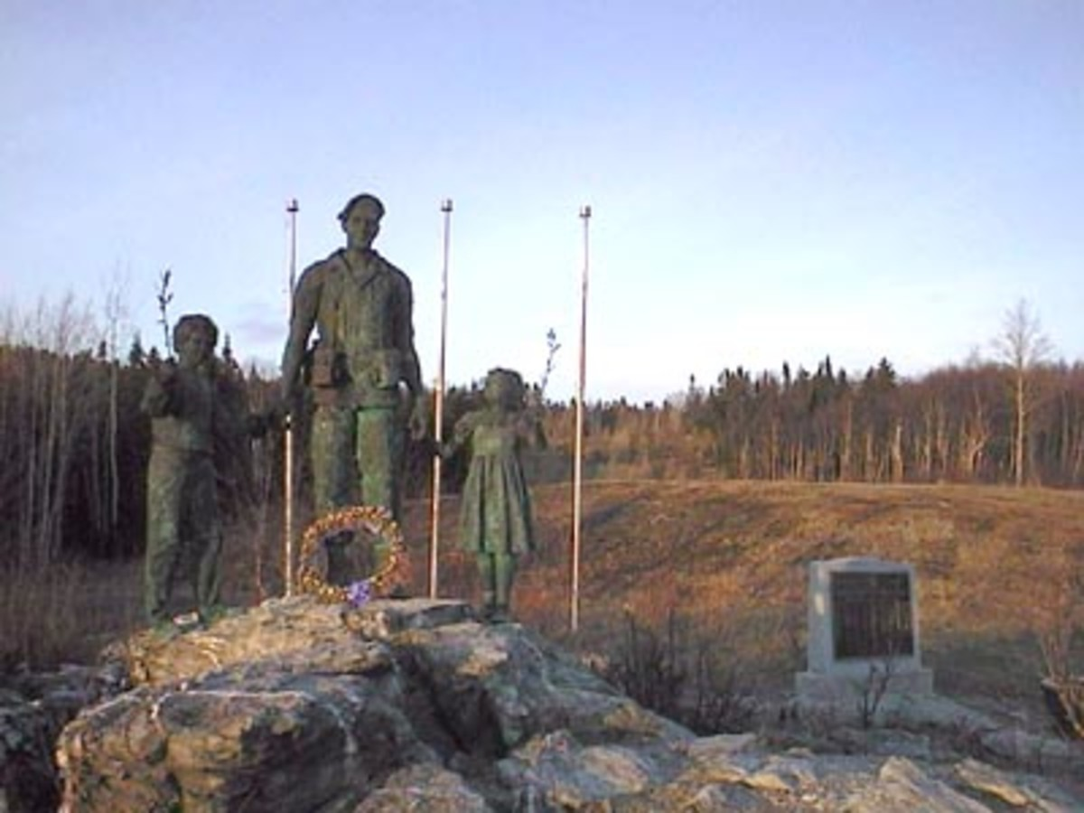"""The monument entitled """"Silent Witness"""" a forever memory to Flight 1285, is located over looking the crash site of the charter Arrow Air DC-8 at Gander Lake, Newfoundland."""