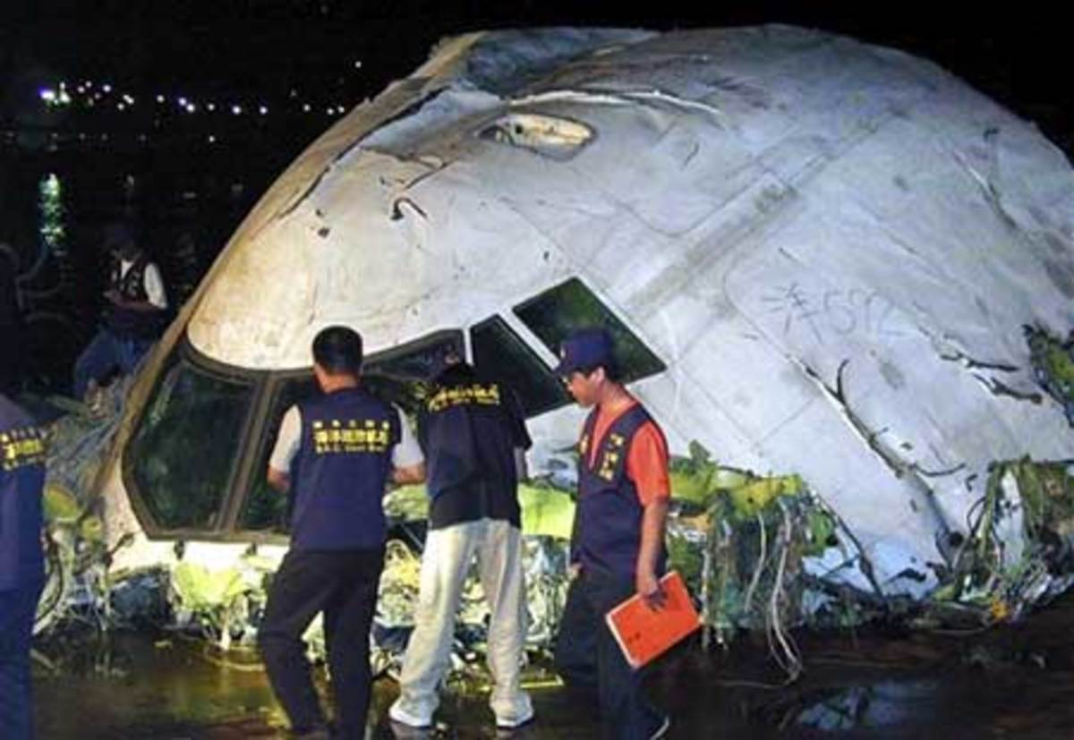 In this June 23, 2002 file image, Taiwan coast guard inspect the cockpit of the China Airlines Boeing 747-200 flight 611 recovered from the Taiwan Strait on the outlying Taiwan island of Penghu, on the main island of Penghu, Taiwan.