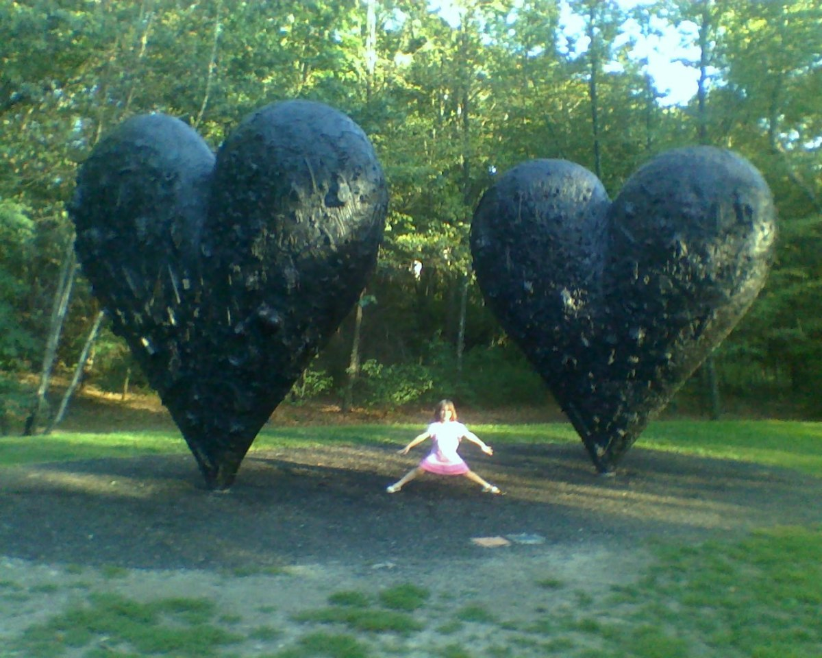 Standing between 2 giant hearts at DeCordova Sculpture Park