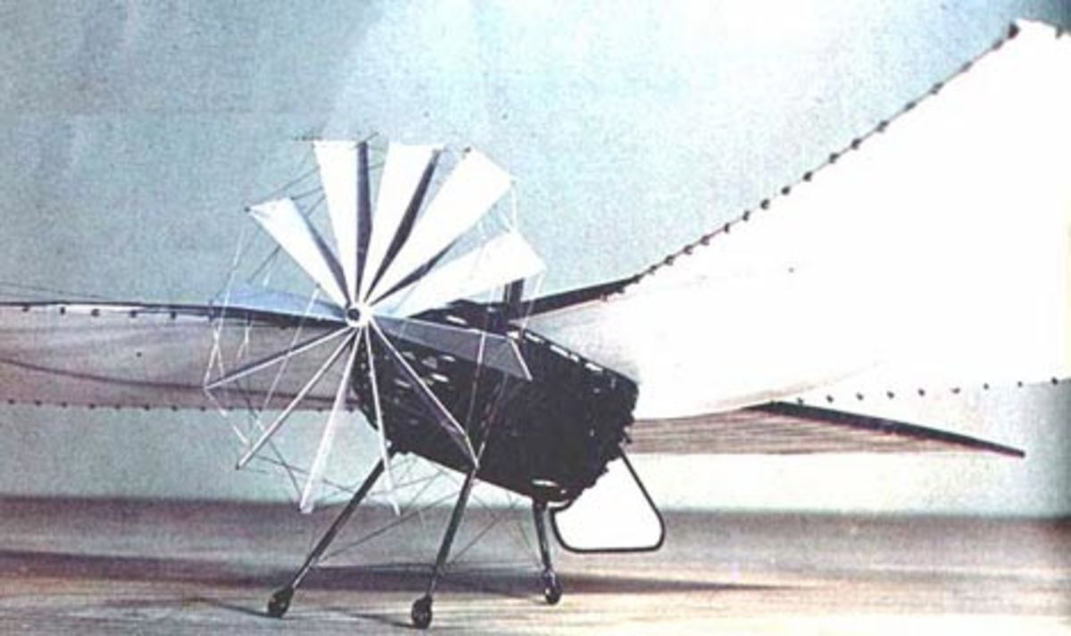 flying-machine with retractable wheeled landing gear, a tractor propeller, an internal engine and a boat-shaped hull
