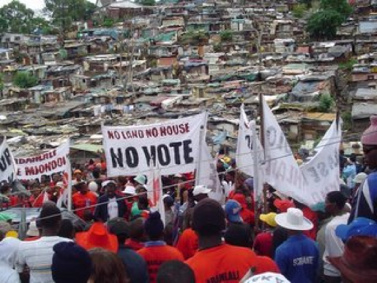The slum dwellers holding a rally in the background of the Shacks...