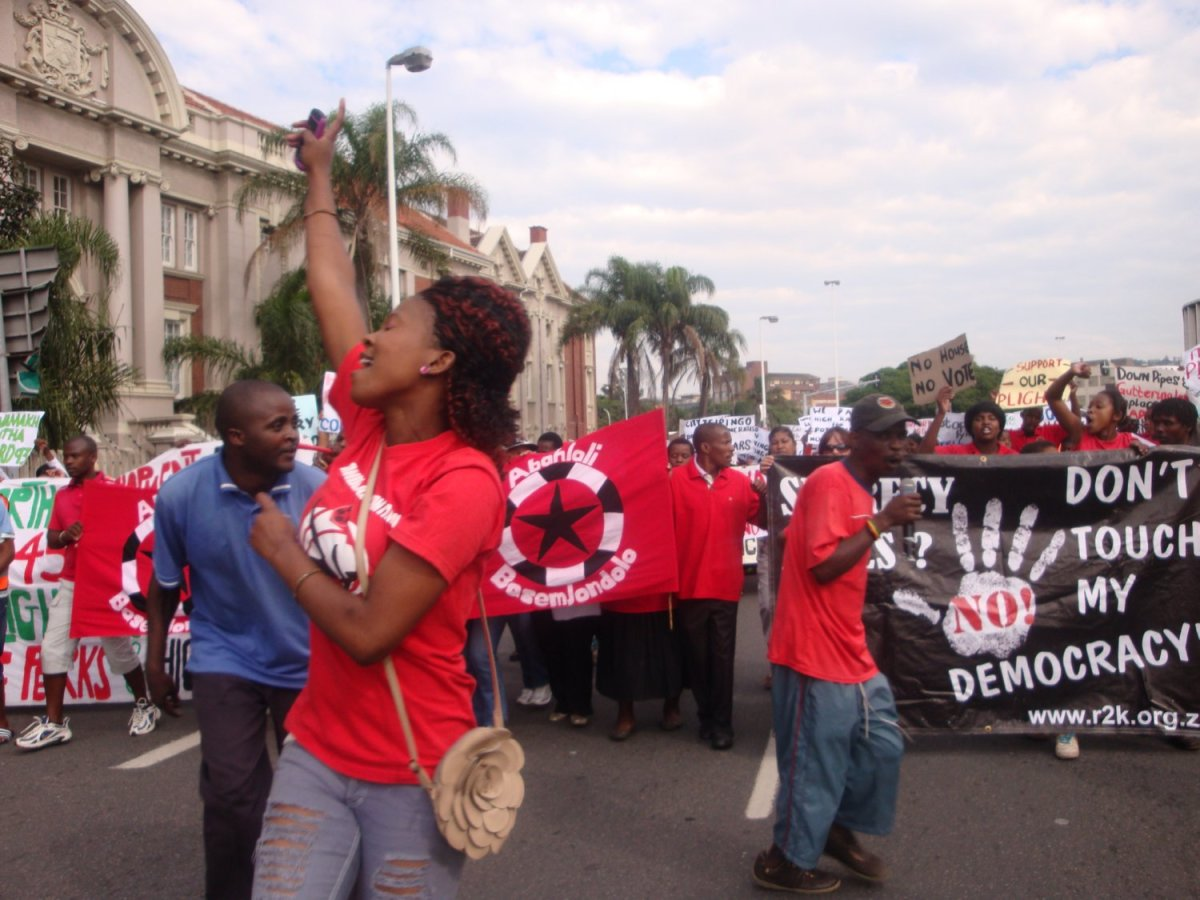 "Abahlali fbaseMjondlolos direct message to the ANC-led government: ""No Land, No House No Vote"" has the African government attacking and killing some of these poor peoples... On the Picture in a euphoric and demonstrating mode"