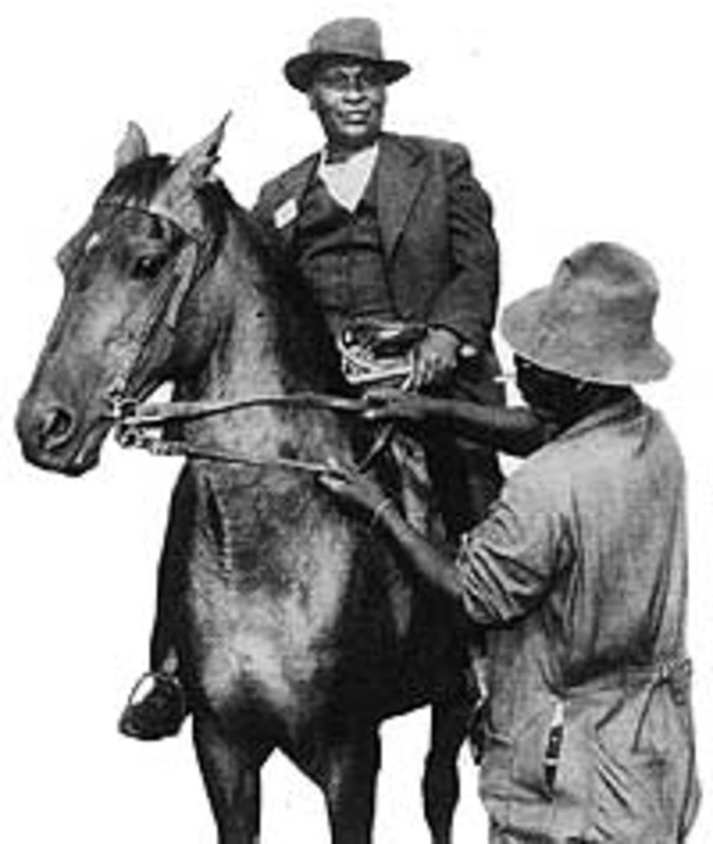 "James Sofasonke Mpanza riding on one of his ""Racing Horses""-of which he had several more, and is known as  the Father Of Soweto"