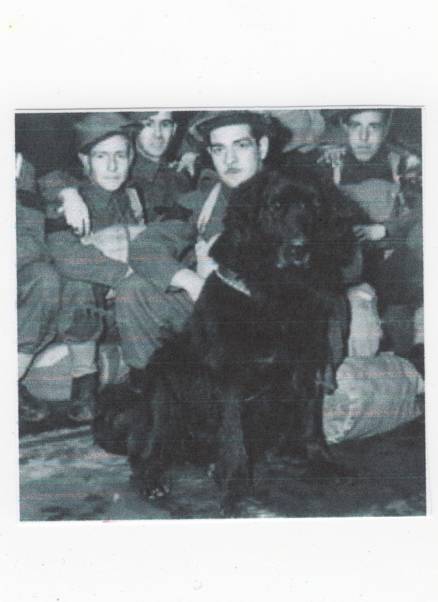 Gander -- a hero of the Battle of Hong Kong -- December 1941. He is here with his army companions for whom he gave his live.