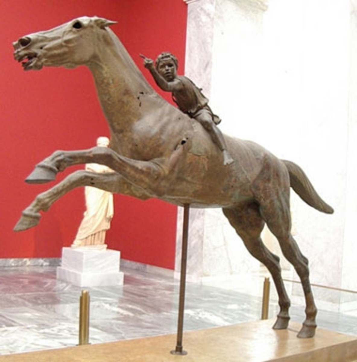 Late Hellenistic bronze statue, c. 140 BCE. The dynamic pose and the strain depicted in both figures is typical of Hellenistic art, which shifted from ideal and austere to gritty realism and the (melo)dramatic.