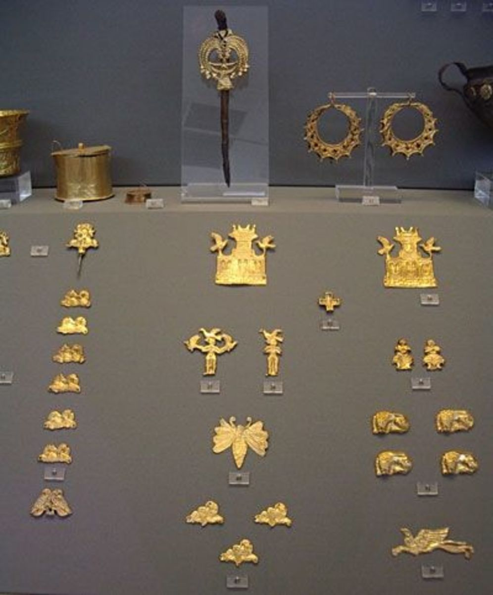 Fine gold jewelry, including butterflies and stylized buildings, from Mycenae.