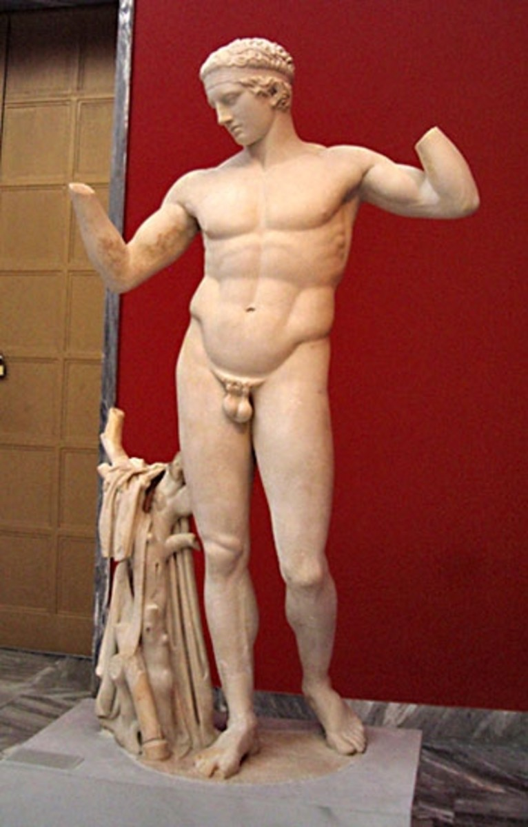 Full-length photo of the Diadoumenos, Polykleitos' well-known statue of an athlete crowning himself. The weight shift onto one hip that Polykleitos first captured became a staple of Greek art. c. 420 BCE.