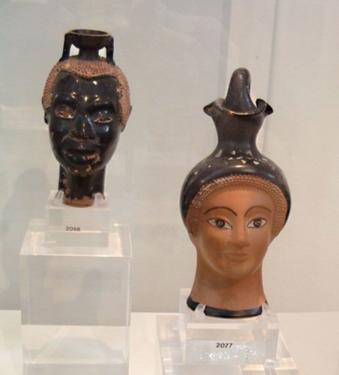 Moving into the classical period, early 5th century BCE. Perfumes were sold in mini vases like this; I wonder if the exotic facial types are meant to suggest where they come from.  (For students, this is Athens NM 2058 and NM 2077)
