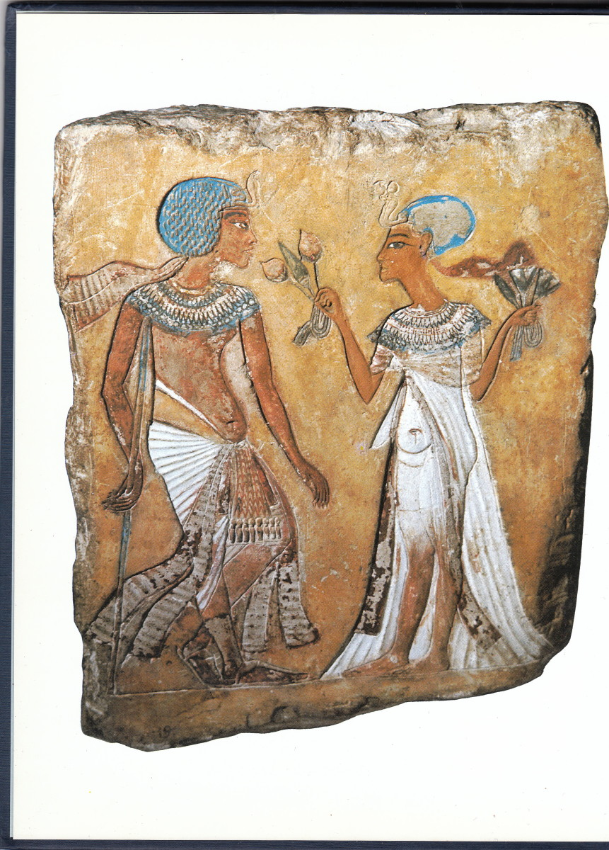 Painted limestone relief with Merytaten offering mandrake fruit to her husband, Smenkhkare in the Berlin Museum