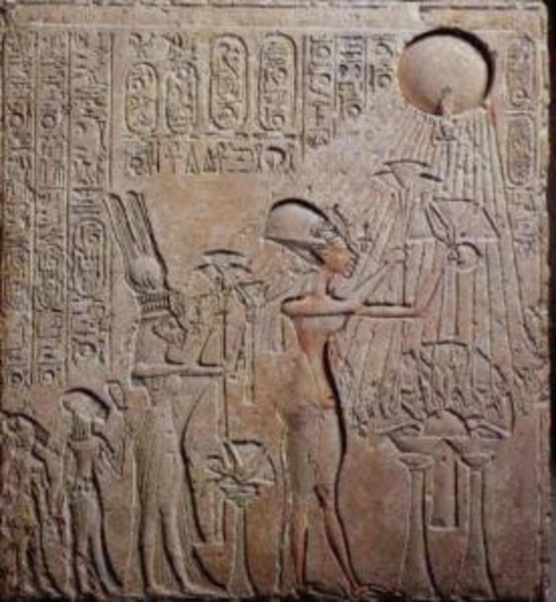 This limestone relief found in the Royal Tomb at Amarna depicts Akhenaton, Nefertiti,and two of their daughters making an offering to the Sun-disk, Aten