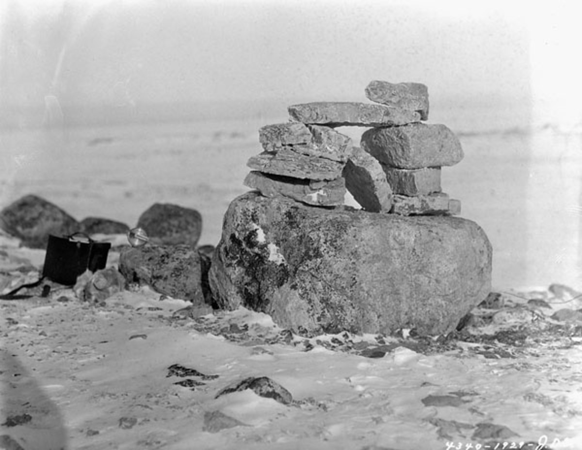 Inukshuk on a plateau at the northern extremity of Baffin Island in Nunavut, Canada. Public domain: March 31,1929.
