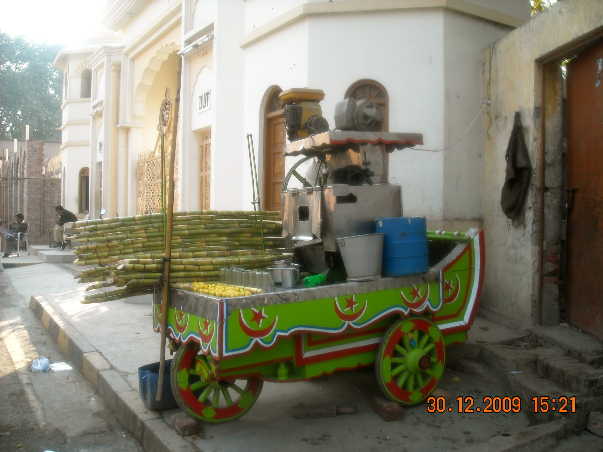 Cane juice is a popular drink! Yes, that contraption is actually a juice machine!!