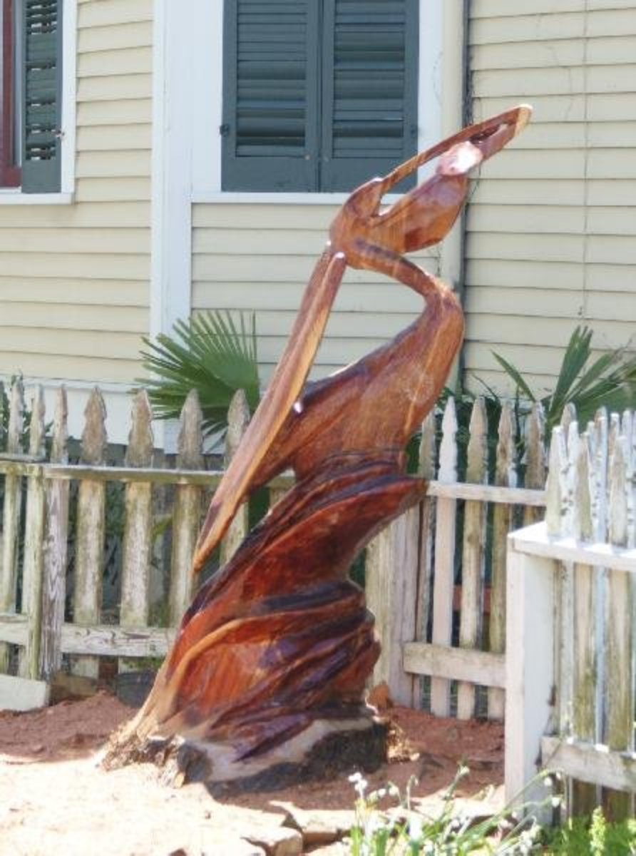 A James Phillips sculpture of a pelican made of cedar is located at 1609 Post Office in Galveston. Image Copyright  2010 Paul Roberts