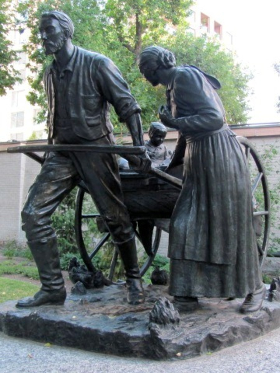 The Handcart Pioneer Monument, a statue commemorating Mormon handcart pioneers, found on Temple Square in Salt Lake City, Utah. The original 1926 bronze by Torleif Soviren Knaphus was reproduced life-size in 1945 for The Church of Jesus Christ of Lat