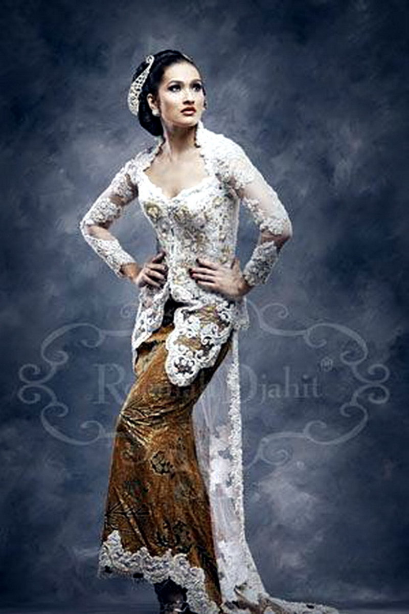 Traditional Kebaya for wedding with the touch of modern design in it's tail and skirt