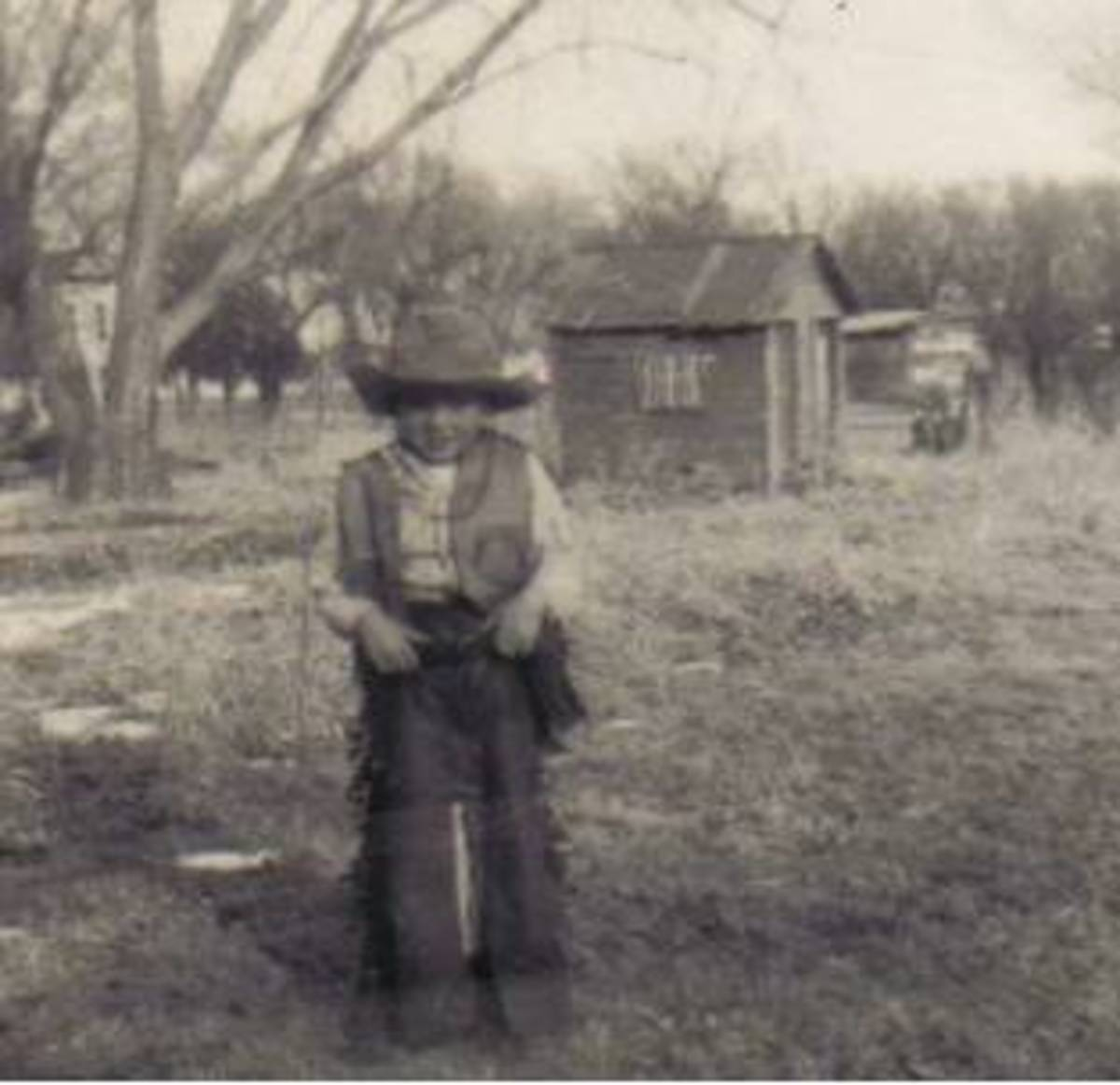 My brother in his full cowboy outfit. I wrote about the time he fell off a saddle that was on a wooden fence. He broke his arm.