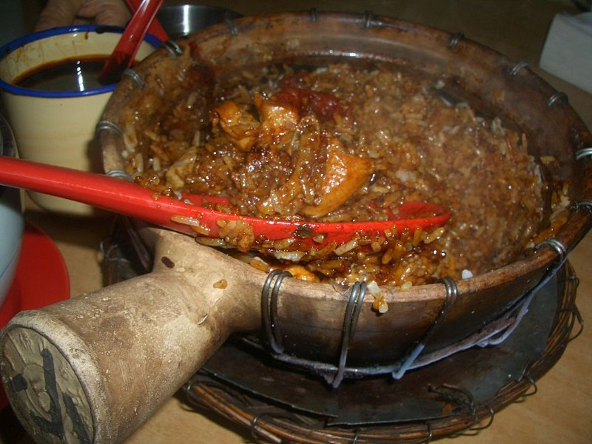 Singaporean chicken and rice cooking served in the unglazed clay pot in which it was cooked.  This is a file from the Wikimedia Commons.
