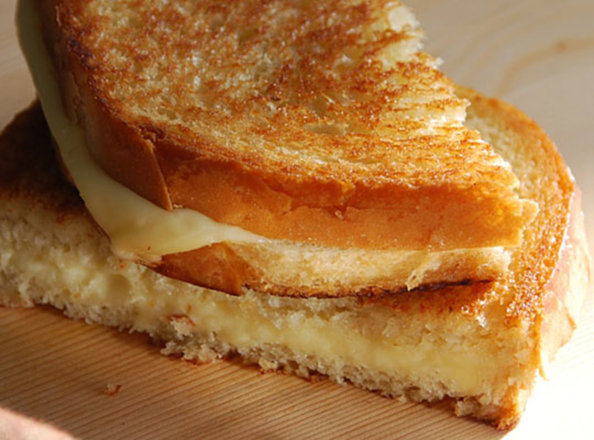 Your basic grilled cheese sandwich is made of American cheese and white bread.