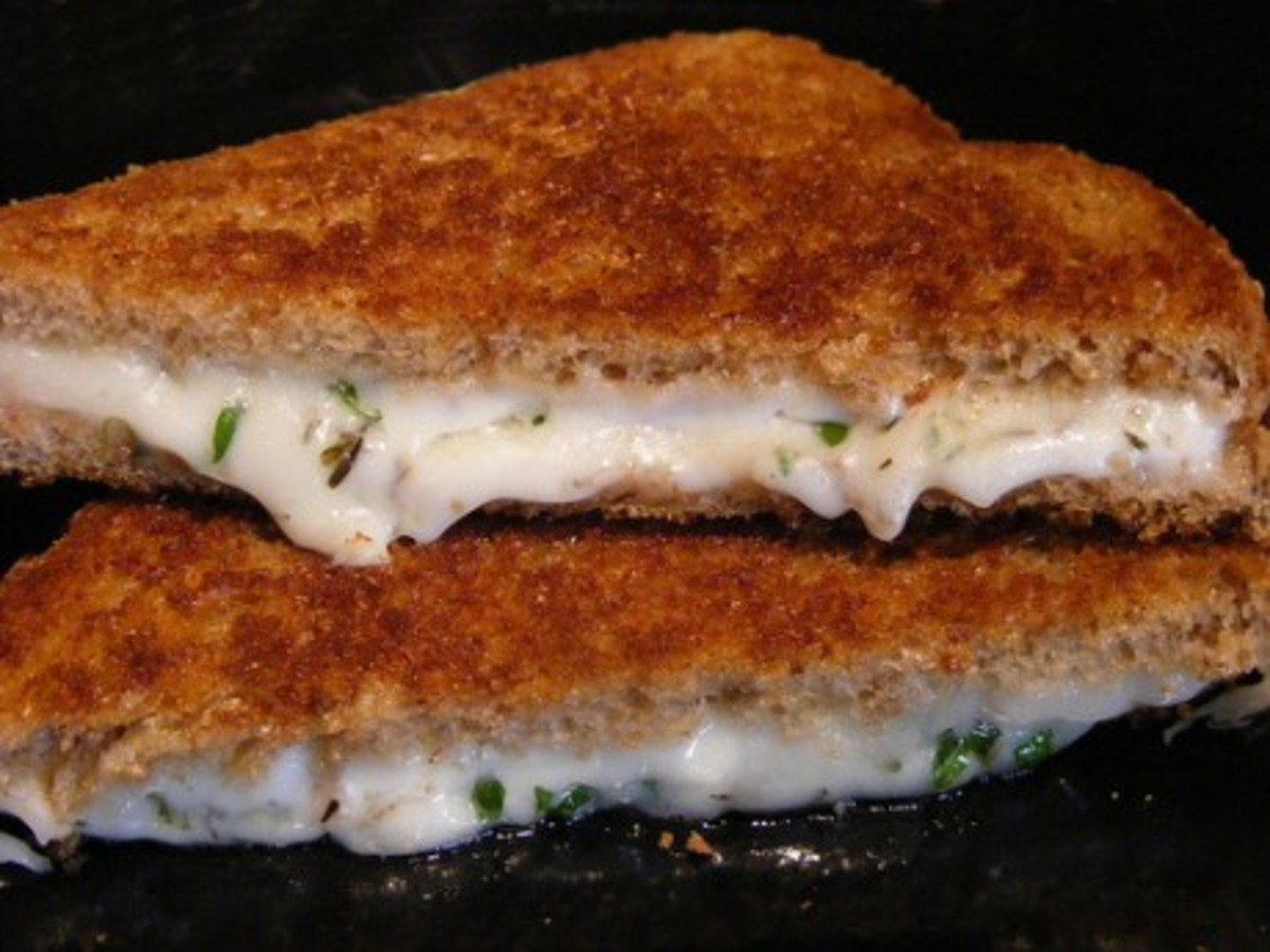 Delicious Grilled Cheese Sandwich made from creamy herbed goat cheese. You just have to try a grilled cheese sandwich made this way. Add Brie and Bacon for a almost sinful sandwich.