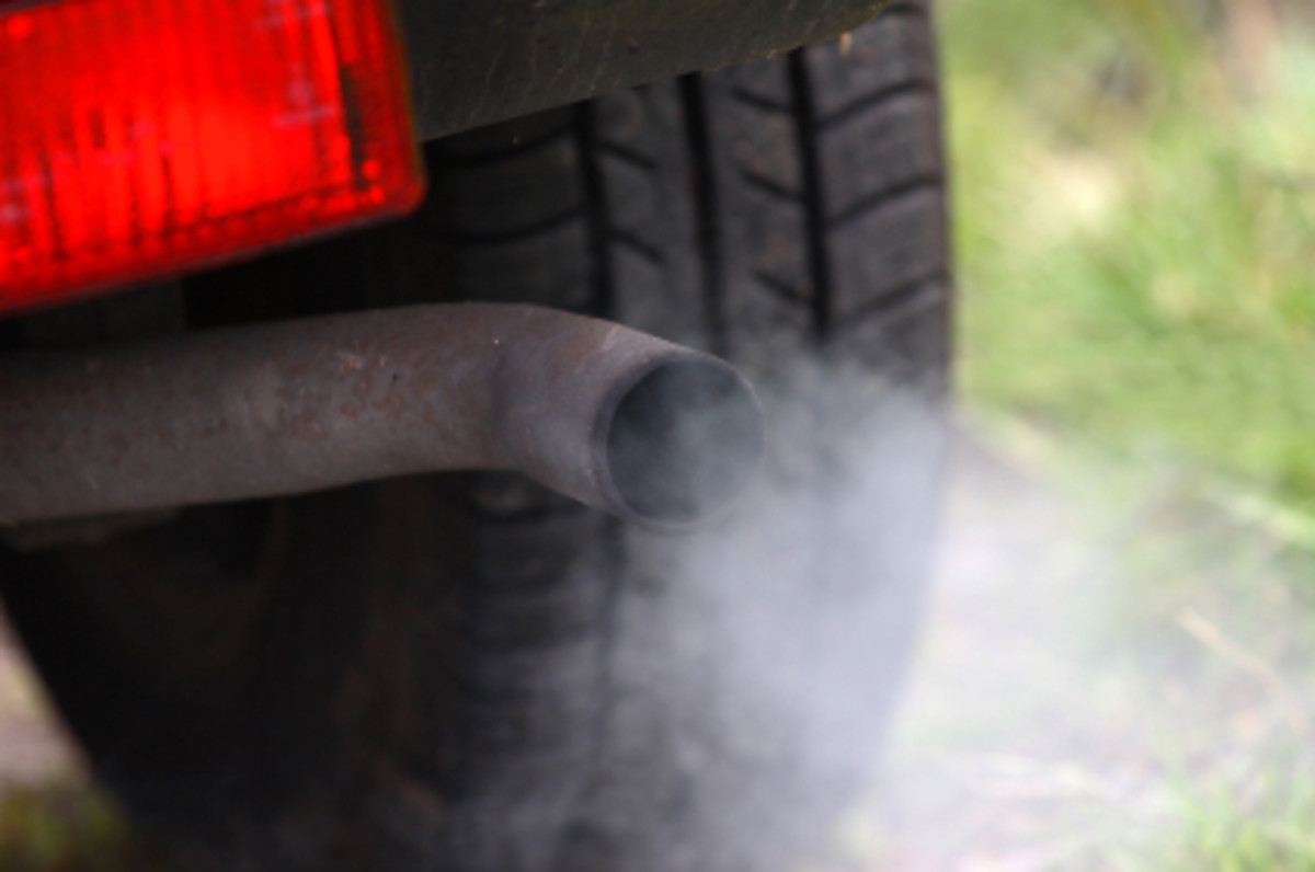 An oil leak can cause excess smog.  Use engine oil stop leak to correct this nuisance.
