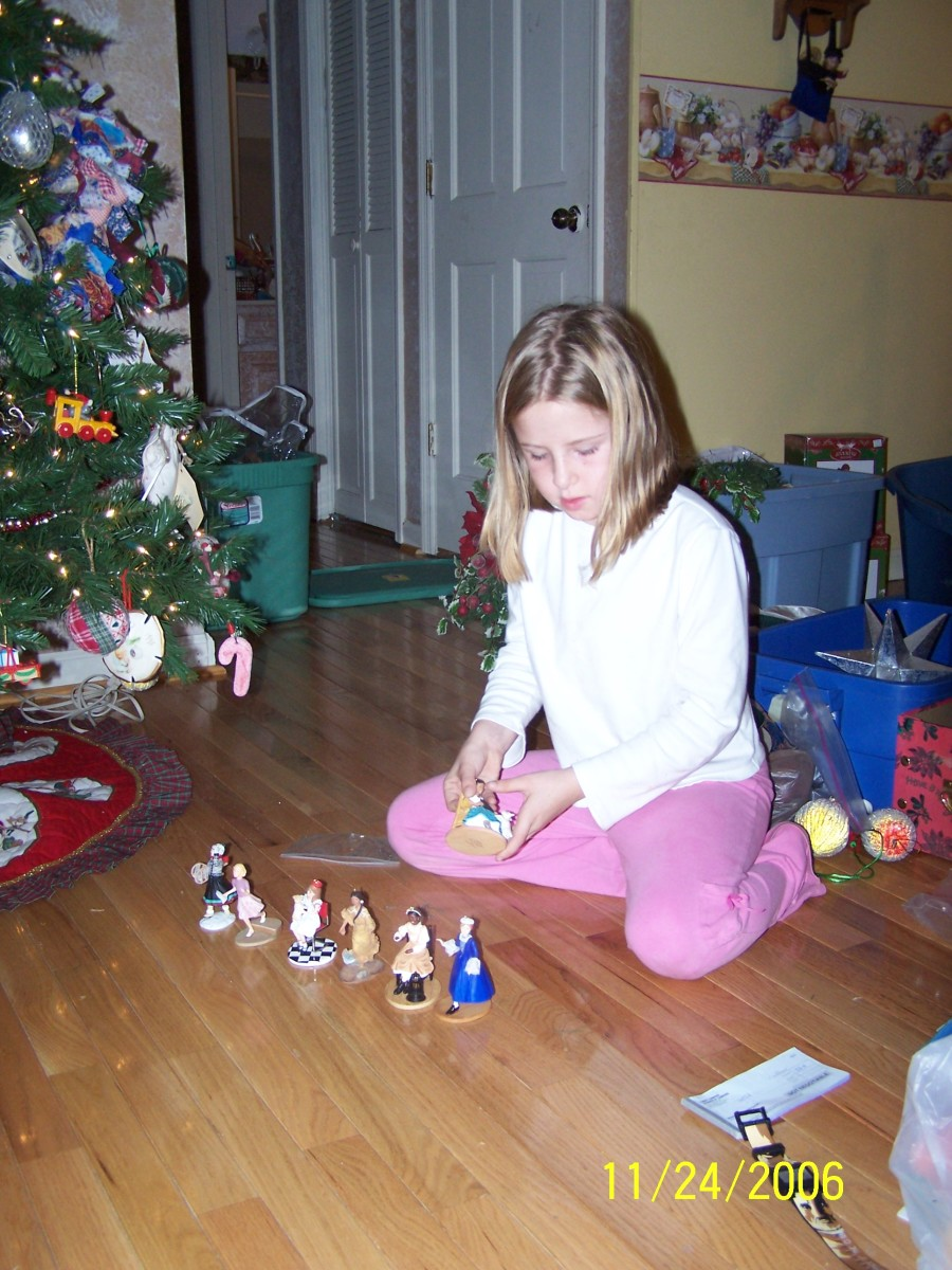 My daughter with her American Girl ornaments she had up through Christmas of 2005.