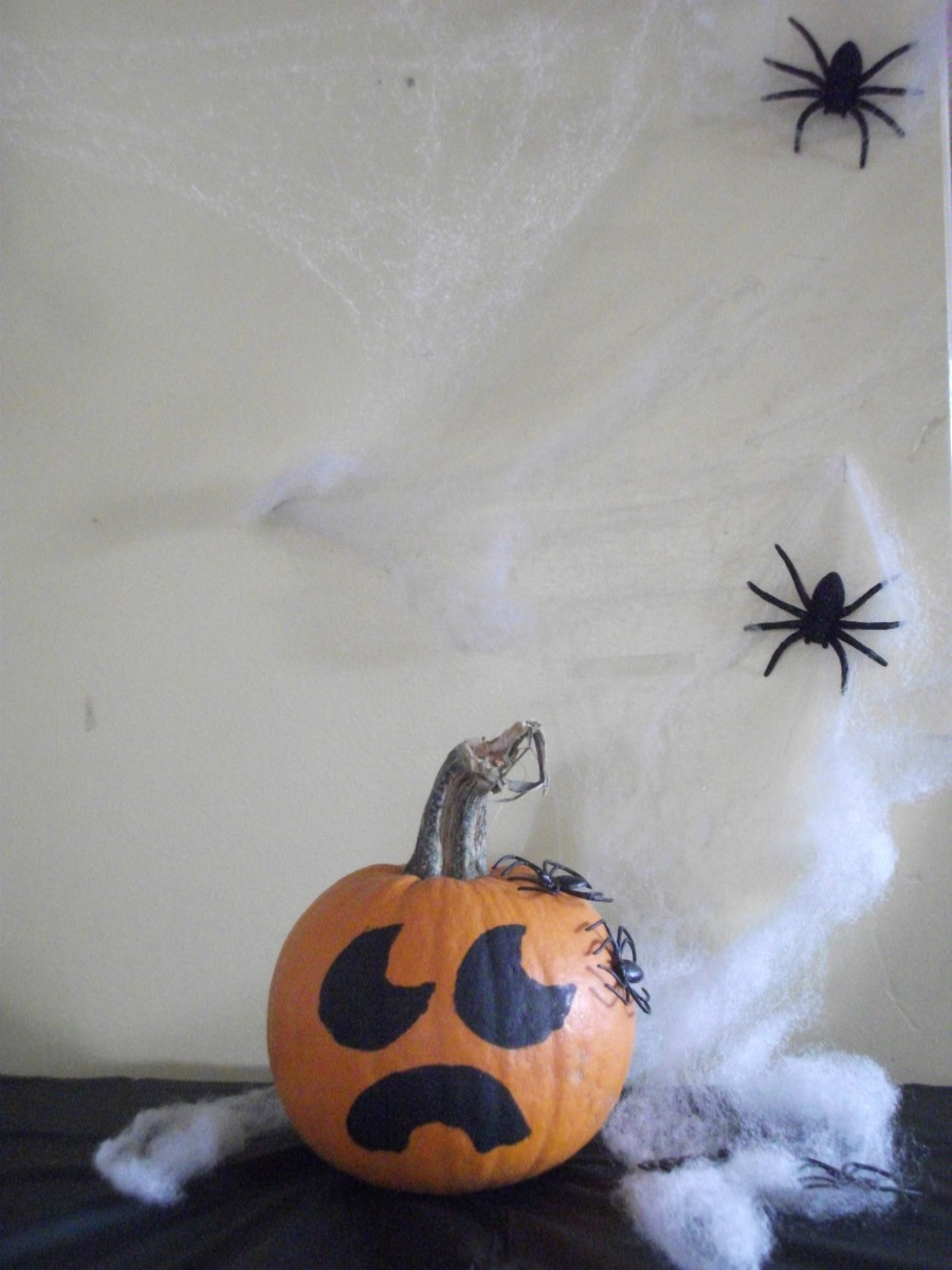 Put your pumpkin under spider web and put spiders around it like it is under attack.