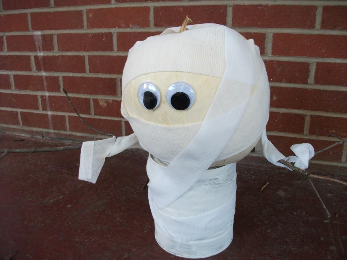 Cute mummy pumpkin waiting to greet trick or treaters.