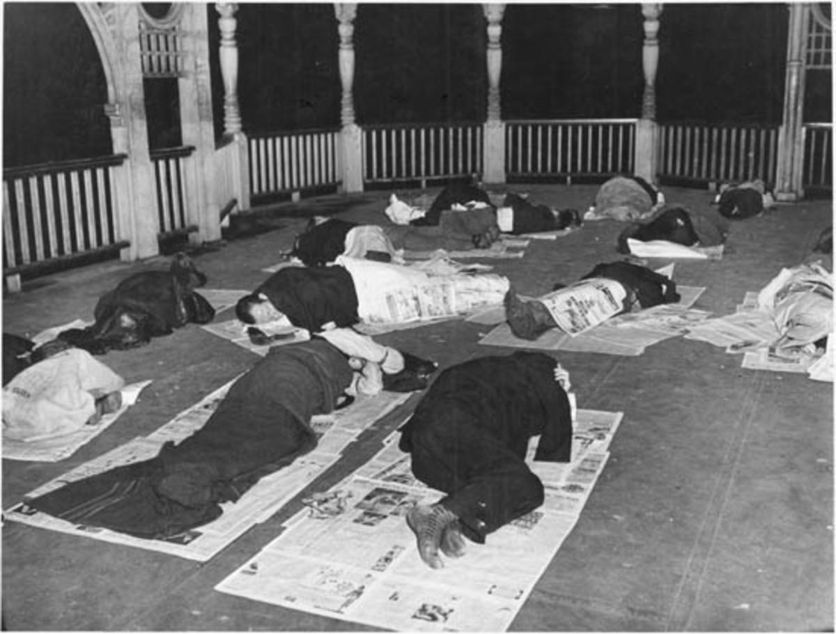 Unemplopyed men sleeping in a bandstand in Toronto, Ontario CA.