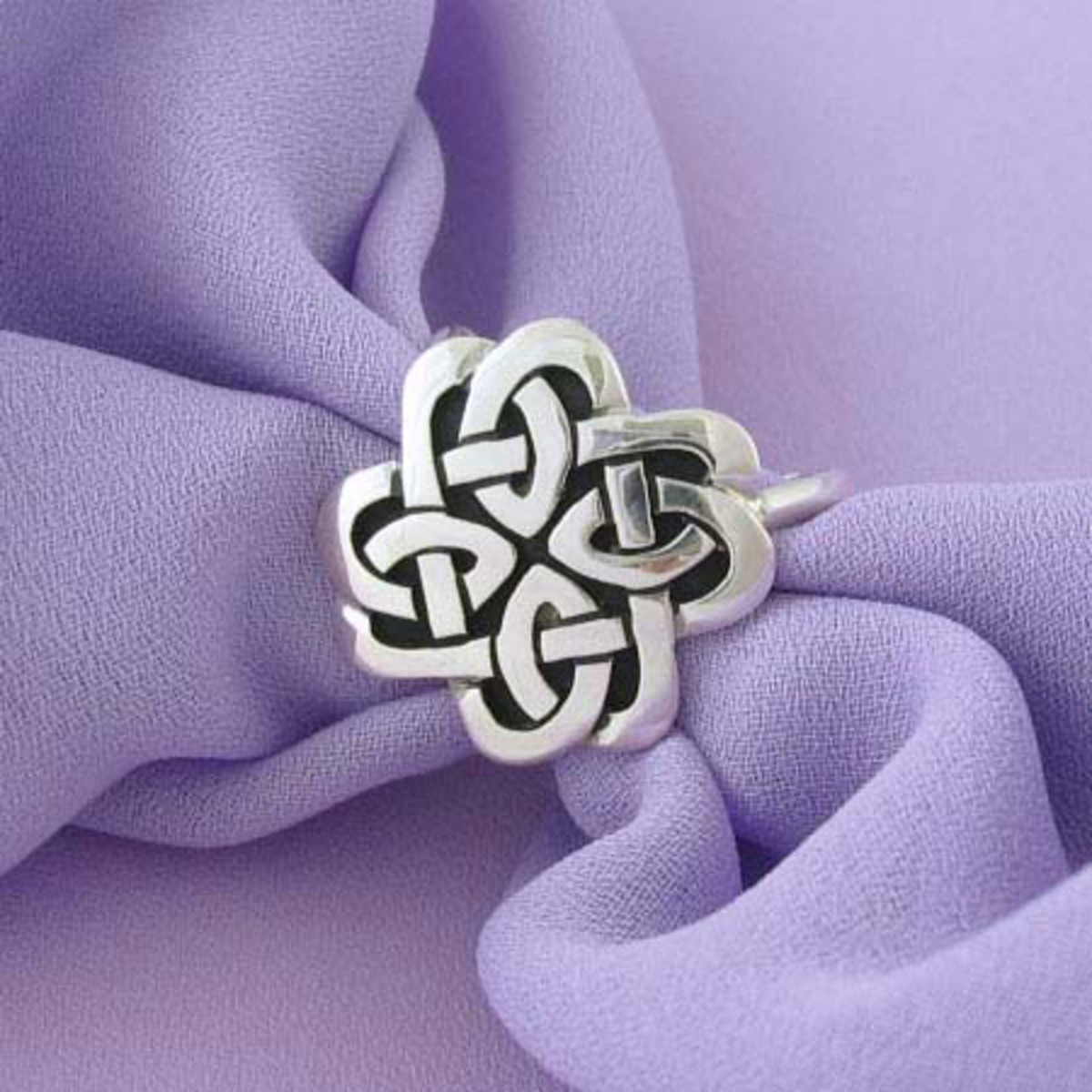 beautiful silver Celtic knot scarf ring with a purpole scarf