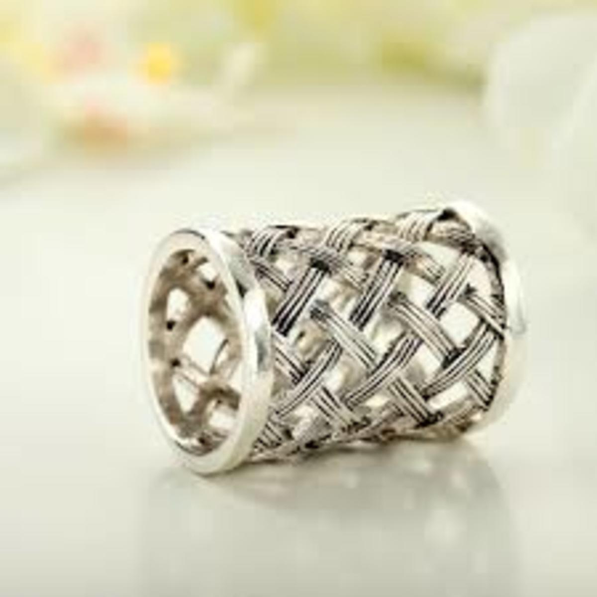 beautiful and intricate antique silver scarf ring