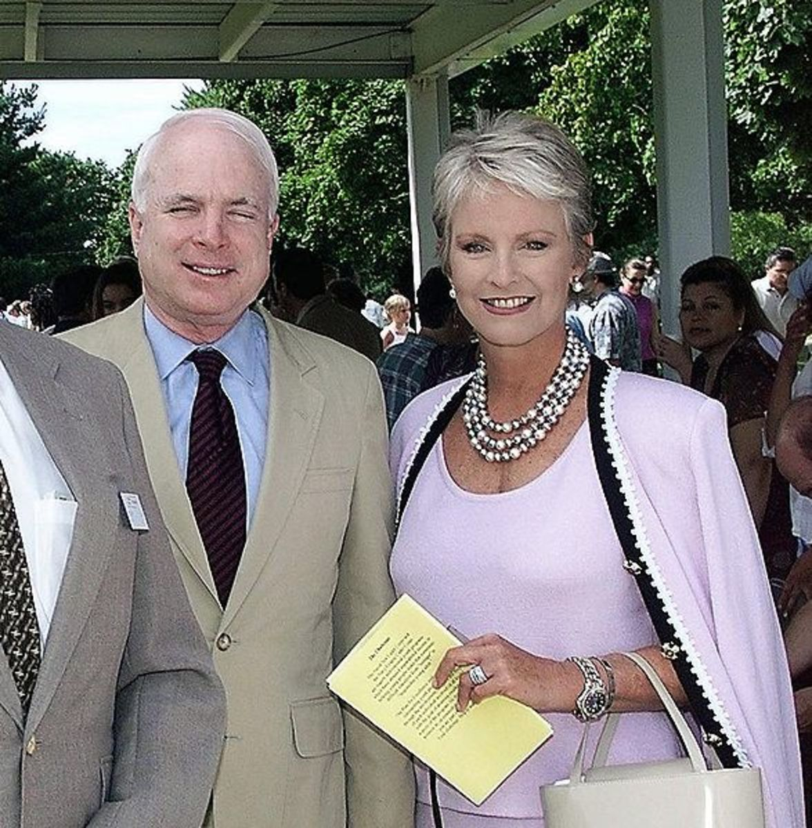 Cindy McCain wearing a 3 strand pearl necklace - photo from wikipedia taken at a graduation with her husband Senator John McCain