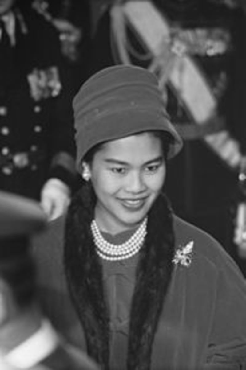 Queen SiriKit (as a young woman - Queen of Thailand) wearing a multi-strand pearl necklace in a black and white photo
