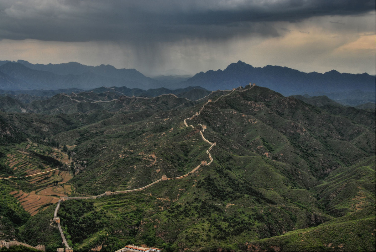 Great wall with brooding storm. Photo courtesy of China Travel.com