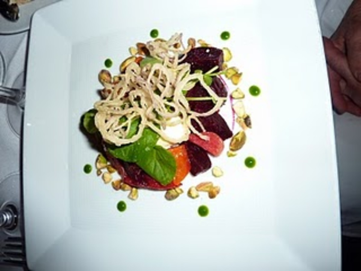 Roasted baby beets highlight a seasonal salad that also features watercress, pistachios and a Rock Hill Creamery feta mousse with a fine blood-orange vinaigrette.
