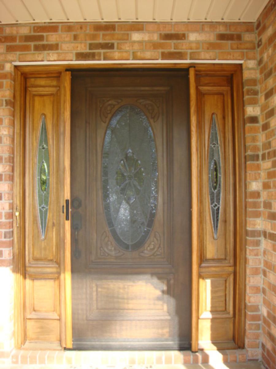 Screen extended across door