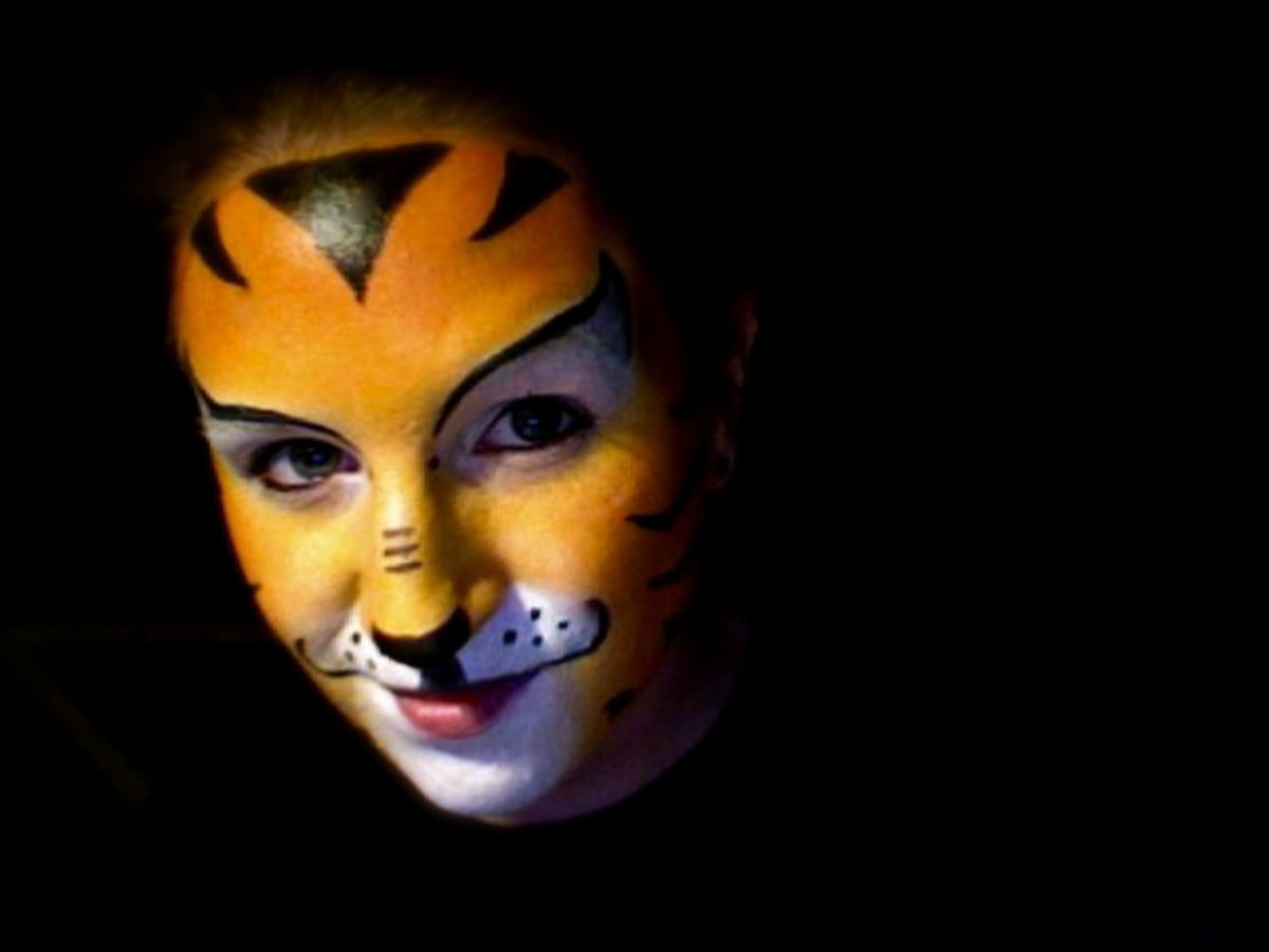 Face Painting Tutorials: How to Paint an Easy Tiger Face for Halloween