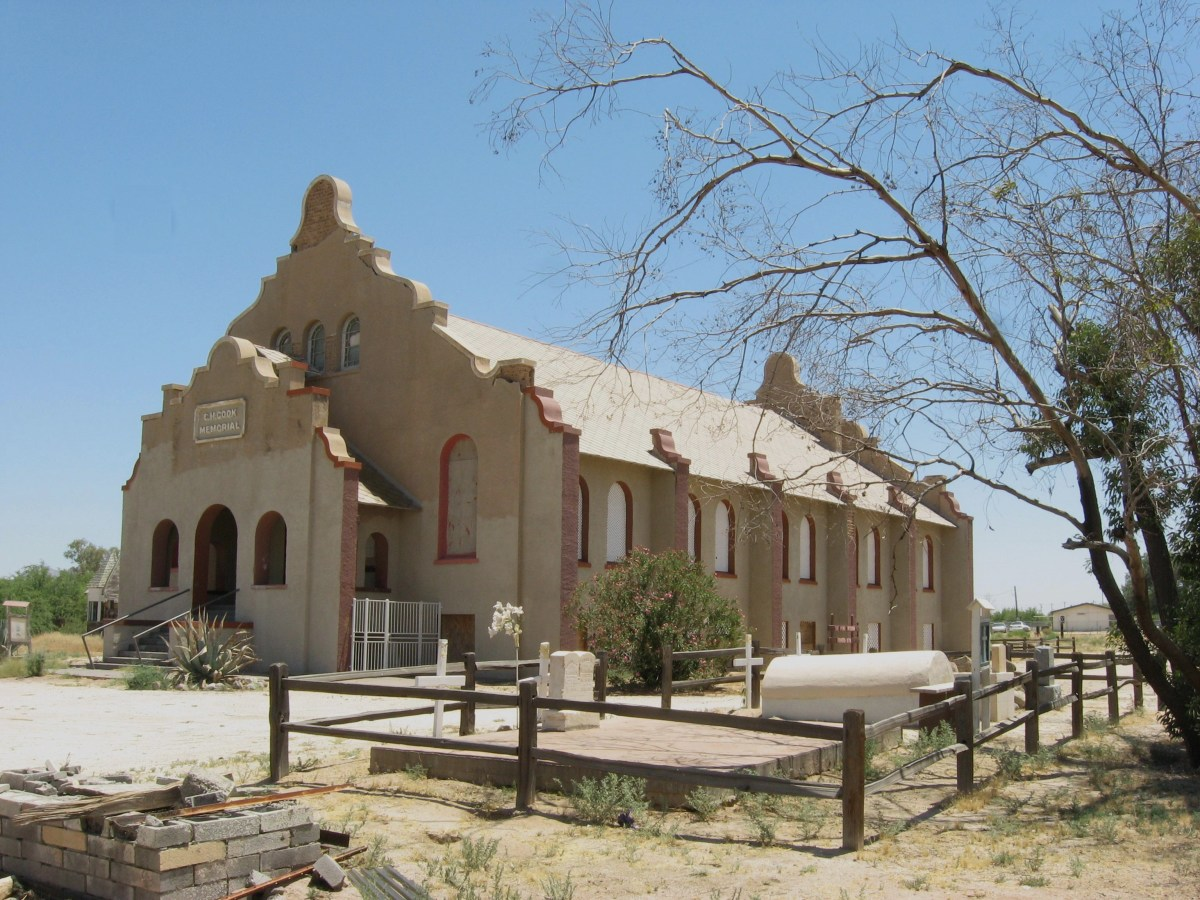 Full view of historic Cook Church and its small cemetery in Sacaton, Arizona