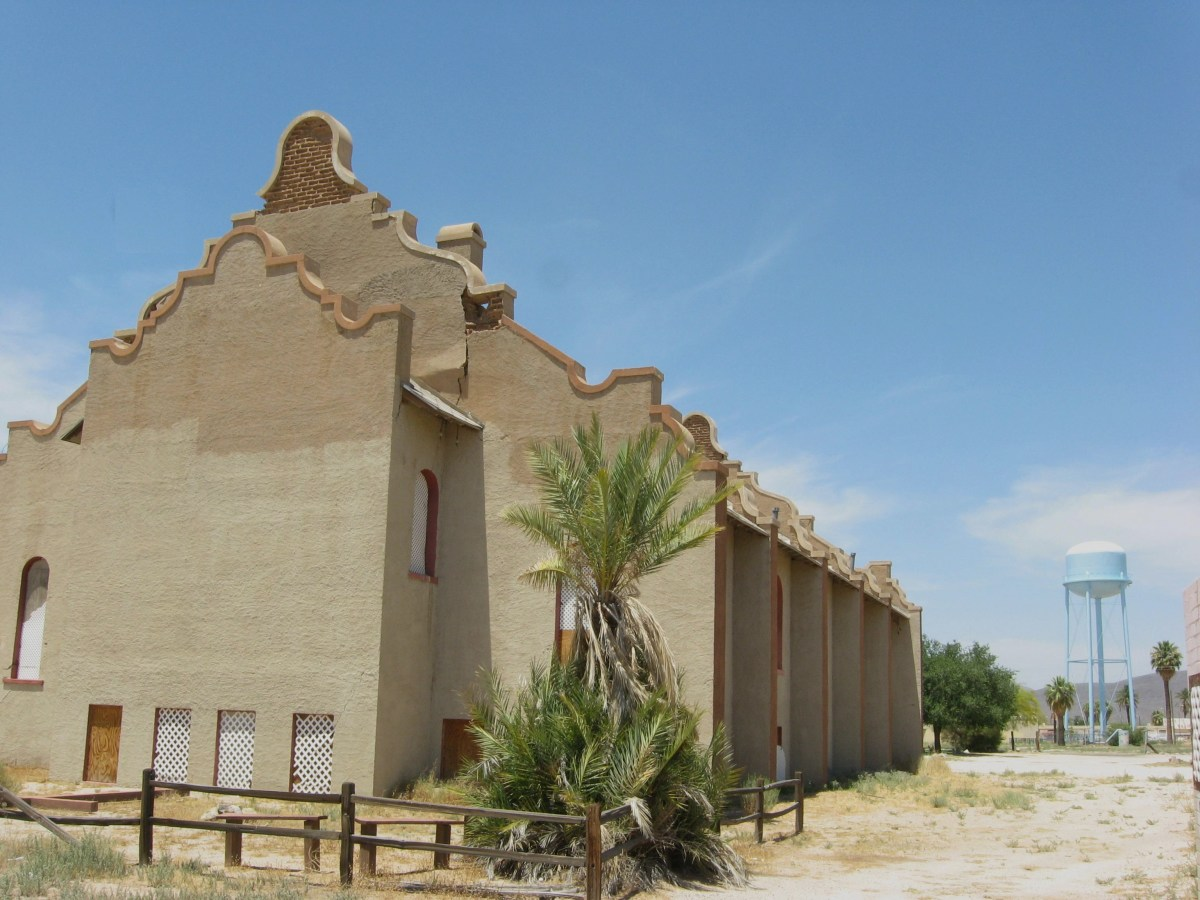 Side view of historic Cook Church and the tall water tower that makes church easy to find in Sacaton, Arizona